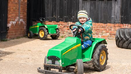 Elliott Duncan having fun on the mini-tractor at Easton Farm Park. Picture: Sarah Lucy Brown