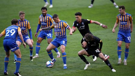 Shrewsbury Town's Ollie Norburn (left) and Lincoln City's Jorge Grant battle for the ball during the