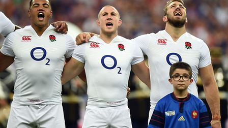 England's Chris Robshaw, Mike Brown (centre) and Luther Burrell (left) singing the national anthem.