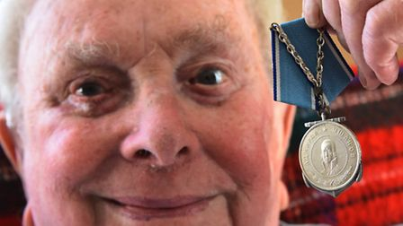 Jack Smith with his Russian medal. Picture by SIMON FINLAY.