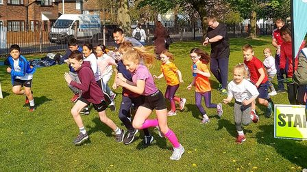 Youngsters set off at the Barking & Dagenham junior parkrun in Parsloes Park