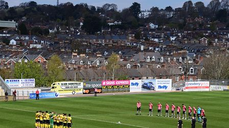 Players hold a minutes silence for Prince Philip during the Sky Bet League 2 Match between Exeter Ci