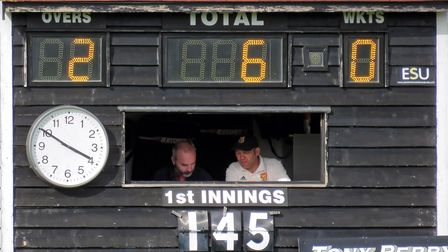The scoreboard at Dunmow Cricket Club with Mark Sykes and Mark Rosewell scoring