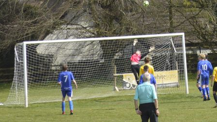 Russ Bracey making the save for Brixington Blues