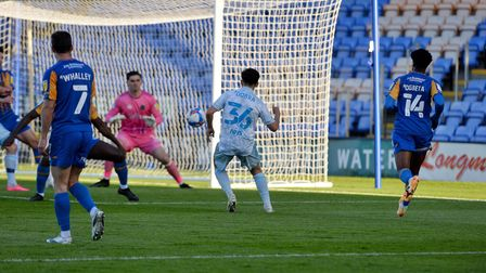 Armando Dobra forces a save from the keeper at Shrewsbury Town.
