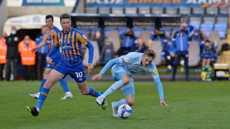 Flynn Downes is tripped by an opponent at Shrewsbury Town.