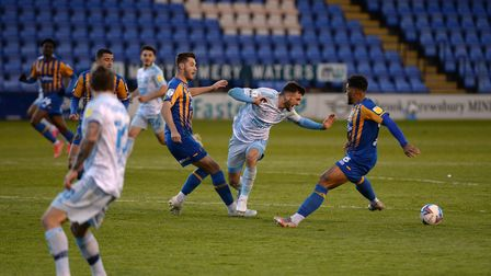 Troy Parrott is fouled at Shrewsbury Town.