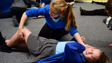 George White Junior School children learn the recovery position from the St John Ambulance during th