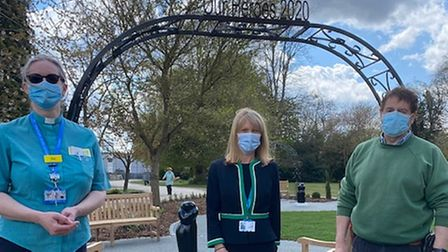 Sue, Clare and Richard at the entrance to Broomfield Hospital's Garden of Remembrance. The arch states Our Heroes 2020