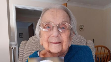 Hilda Sayer, who lives at Weaver's Court in Diss, with her 100th birthday card from the Queen
