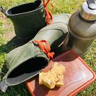 No bake white chocolate bars on a tupperware tub with wellies and a water bottle