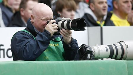 Paul Chesterton taking photos at a Norwich City match.