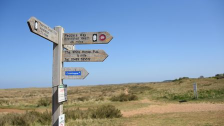 The signpost for the Norfolk Coast Path and the Peddars Way at the beach at Holme-next-the-Sea