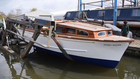 The Noisy Goose, a renovated 1962 wooden Broads cruiser being relaunched at Wayford