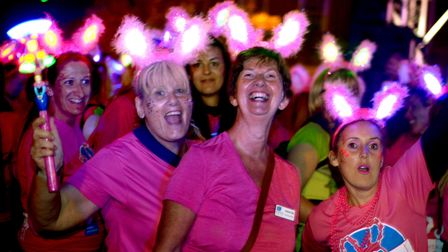 Pretty in pink: A packed Angel Hill in Bury St Edmunds on Saturday night for the start of the St Nic