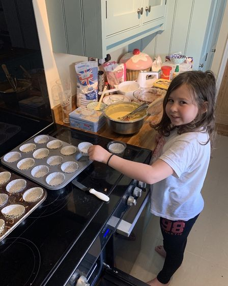 Fundraiser Lydia in the process of making the cupcakes