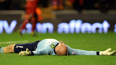 Norwich City's John Ruddy has suffered at the hands of Liverpool and Luis Suarez. Photo: Peter Byrne