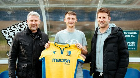 Norwich United boss Steve Eastaugh, left, with Liam Jackson, and assistant manager Andy Eastaugh