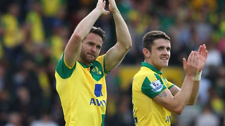 Matt Jarvis of Norwich and Robbie Brady of Norwich applaud the fans at the end of the Barclays Premi