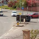 The car tipped on its side after a crash with another vehicle near Tesco