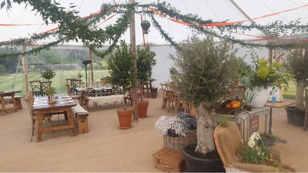 The inside of the dining tent at The Lion Brasserie was furnished by local designers, florists and businesses