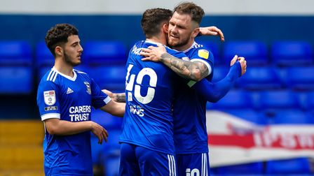 Troy Parrott celebrates with James Norwood after scoring Towns third.