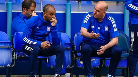 Town manager Paul Cook in discussion with Town U23 manager Kieron Dyer.