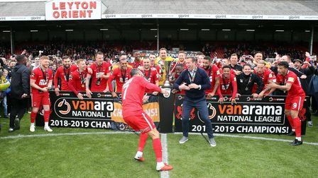 Jobi McAnuff and Justin Edinburgh tease the Leyton Orient players before lifting the National League