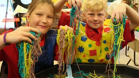 Bright Stars members Charlotte and Sophie enjoying some messy play with coloured spaghetti. Picture:
