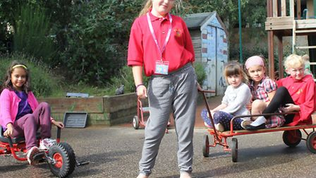 Eight-year-old Charlotte Borrett and fellow Bright Stars members having fun in the after-school and