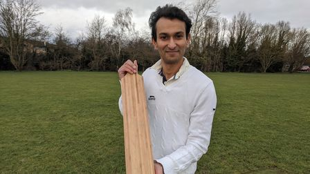 University of Cambridge researcher Dr Darshil Shah with a bamboo cricket bat produced by Suffolk firm Garrard Cricket