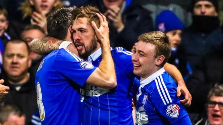 Cole Skuse and Freddie Sears celebrate with Ipswich Town's Luke Chambers after his goal to level thi