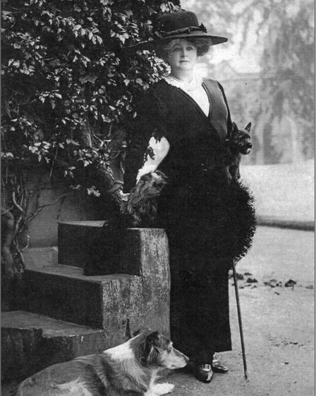 The Countess of Warwick with her dogs. The Countess commissioned Harold Peto to redesign her Gardens at Little Easton