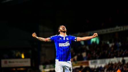 Injury time goal scorer Luke Chambers celebrates Town's victory after the final whistle in the Ipswi