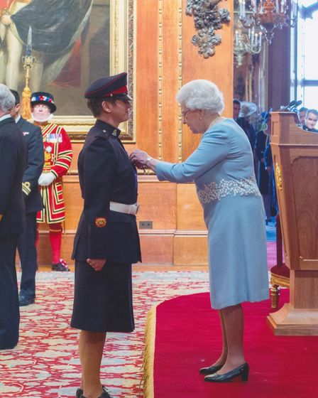 Lou O'Connell being presented with an MBE by Her Majesty The Queen in 2015.
