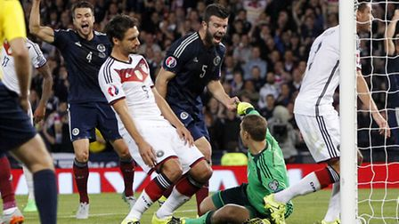 Russell Martin (left) celebrates Germany's Mats Hummels (centre) scoring an own goal during the UEFA