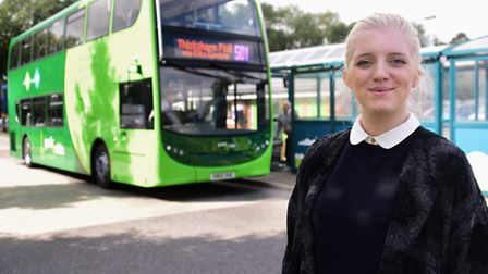 Reporter Jemma Walker with one of the new buses at the Thickthorn Park & Ride. Picture: DENISE BRADL