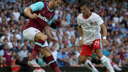 West Ham United's Matt Jarvis and FC Lusitan Leonel Maciel (right) in action during the Uefa Europa