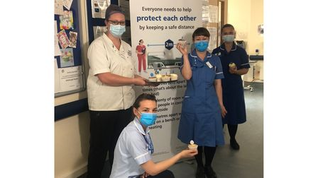 Staff at Aldeburgh Hospital with cupcakes to mark International Nurses Day