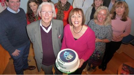 Lord Walpole's 80th birthday celebrations at Sheringham Little Theatre, with Debbie Thompson holding a cake