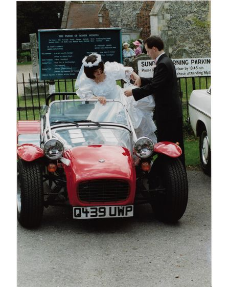 Mary and Graham Dorney with the Caterham Seven sports car on their wedding day in June 1990