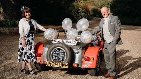 Mary and Graham Dorney with theCaterham Seven sports car they had at their wedding