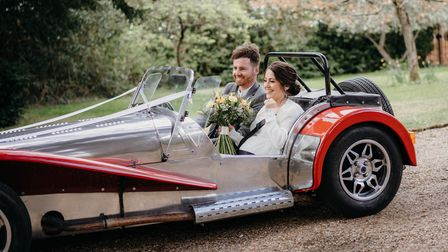 Becky and Lewis in the Caterham Seven sports car on their wedding day