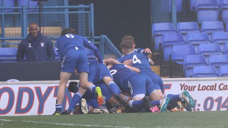 The Ipswich Town players celebrate Edwin Agbaje's opening goal against Liverpool