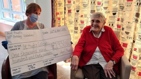 Two women pictured with a giant cheque