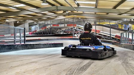 A rider takes to the track at Anglian Indoor Karting in Ipswich