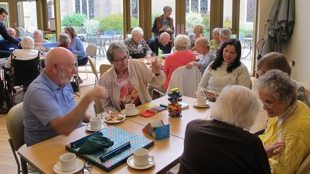 People with dementia and their carers at the Holt and District Dementia Support Group Poppy Cafe meeting in Holt.
