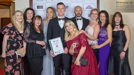 Richard Taylor owner of Tiger Fitness and his members at the Thetford Business Awards in 2019.