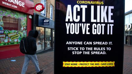 A government coronavirus warning sign warns of the dangers of Covid.
