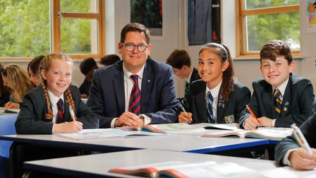 Students at Wymondham College with headteacher Dan Browning.